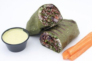 Product image of Vegan Quinoa Wrap pictures with signature spicy vegan sauce and side of carrots